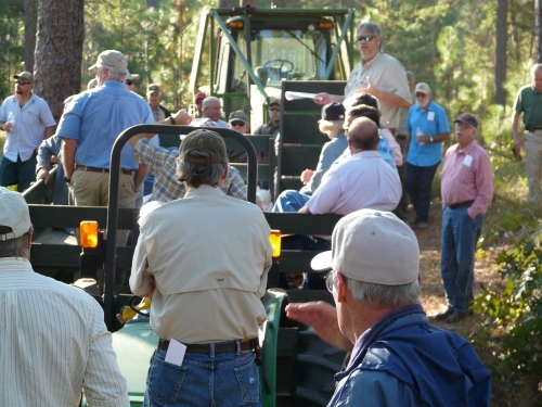 UGA Extension Specialist Dr. David Moorhead discusses storm-damaged trees on a site at Pebble Hill Plantation.
